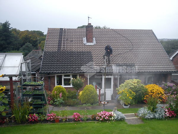 roof during roof cleaning process